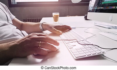 hands at work in creative space - modern office worker in a...