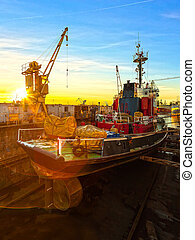 Ship in dry dock - Ship being repaired in dry dock at...