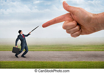 business accusation - giant finger pointing aggressively at...