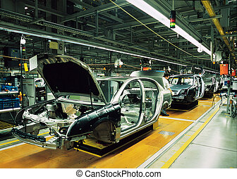 car production line with unfinished cars in a row