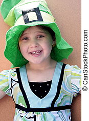 Little girl in St Patricks day hat - Little girl wearing a...