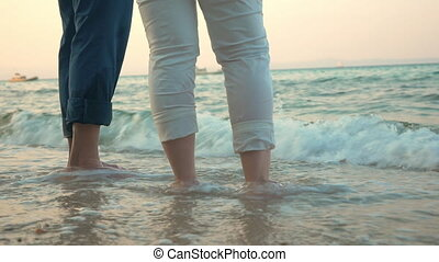 Barefoot man and woman on the beach - Senior man and woman...