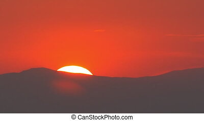 Red Sunset over the Mountain - Sun is setting over the...