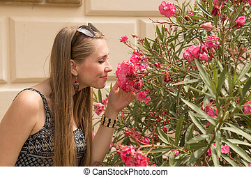 Young woman smelling flowers