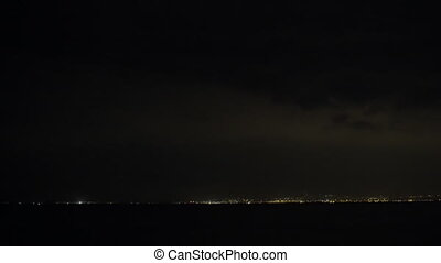 Lightnings in night sky over the city - Distant view of...
