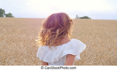Young woman girl in white dress running on the Field -...