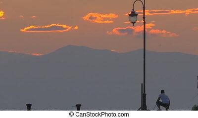 Man Fishing in Twilight