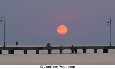 Cinemagraph - Sun Setting over the Sea Pier - Cinemagraph -...