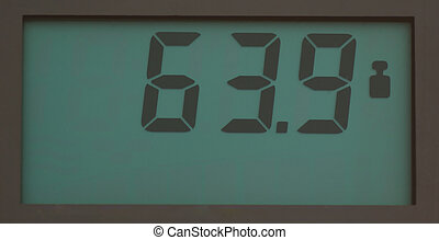 Scale showing 63.9 kg - Scale, showing 64.9 kg on LCD...
