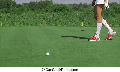 Woman kneels at the golf - Attractive caucasian woman...