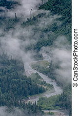 Fog Hangs Low Over Valley River in the mountains of Montana
