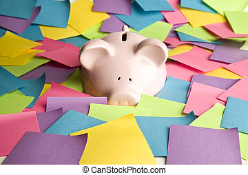 Piggy bank and post it notes - Pink piggy bank up to its...