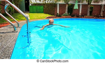 Bearded Old Man Swims along Oval City Swimming Pool -...