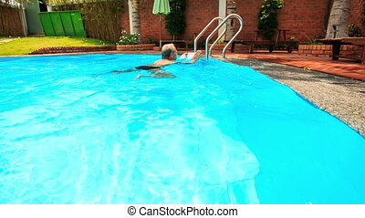 Bearded Old Man Comes out of City Pool by Ladder - european...