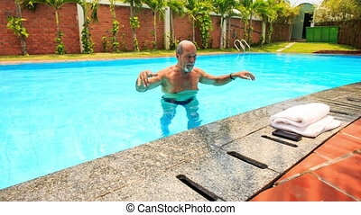Bearded Old Man Dries with Towel Makes Selfie in Pool -...