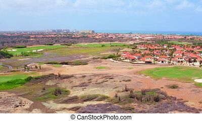 Aerial from a golf field on Aruba island in the Caribbean...
