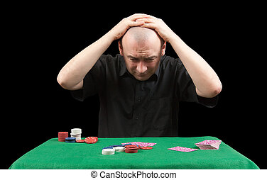 Losings - Poker gambler in black shirt. Losings. Isolated...