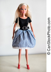 Single blond doll in skirt - Single blond toy doll in knee...