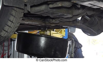 Used oil flowing into car oil replacement equipment...