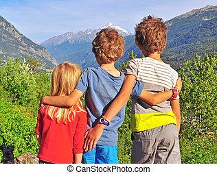 Children in mountains - Three children in mountains
