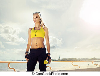 Young and sporty woman posing outdoors - Fit, sporty and...
