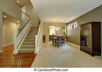 Hallway exterior with dining area with carpet floor. View to...