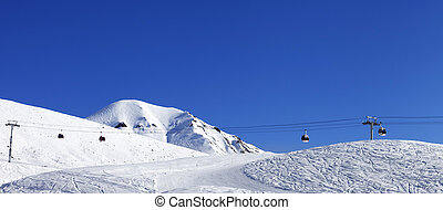 Panoramic view on gondola lift and ski slope at nice day...