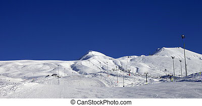 Panoramic view on ski resort at sun day Caucasus Mountains...