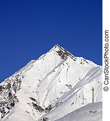 Snowy mountains and blue clear sky in nice day Caucasus...