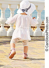 first steps - fashion baby girl doing her first steps