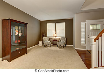Elegant living room in brown tones with two classic...