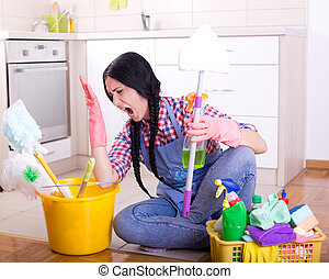 Frustrated cleaning lady - Frustrated young woman sitting on...