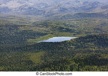 Scenic view from mountain, lake in valley