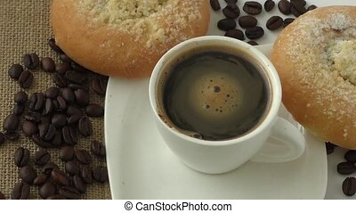 Sweet pastry and cup of black coffee