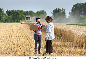 People at harvest - Senior peasant and young farmer girl...