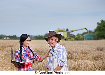 People at harvest - Senior peasant with his granddaughter...