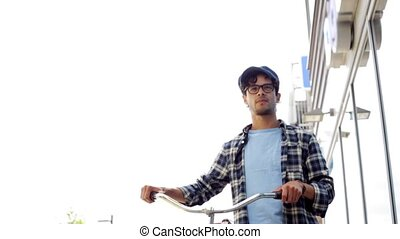 hipster man walking with fixed gear bike on street - people,...