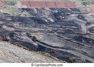 Part of a pit with big mining truck working.