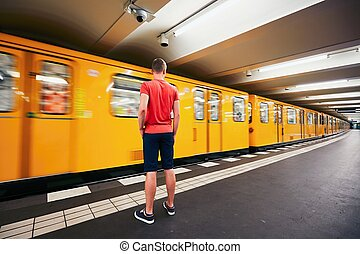 Traffic in subway. Young man is waiting for subway. Berlin,...