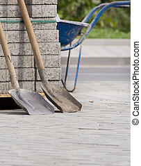 Two shovels at construction site - Two shovels leaning on...