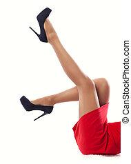 Close up women's slender legs in high heels.
