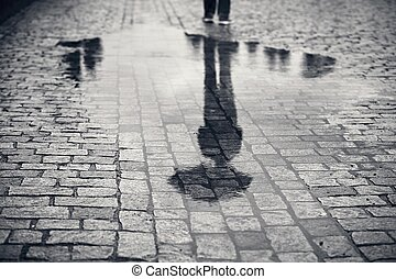 Man in rainy day - Rainy day. Reflection of young man with...