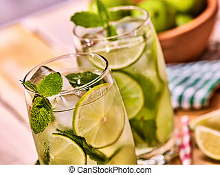 On wooden boards glasses with mohito and scoop ice. -...
