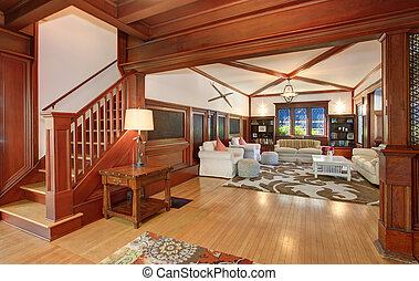 Luxury Living room interior with hardwood floor and vaulted ceiling and beams.