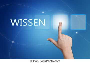 Wissen - german word for knowledge - hand pressing button on...