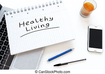 Healthy Living - handwritten text in a notebook on a desk -...