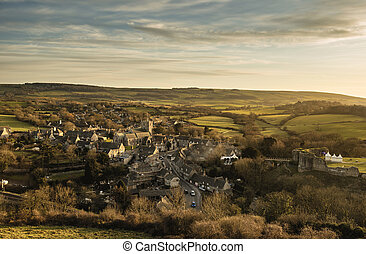Landscape of Corfe village in Dorset during beautiful sunset...