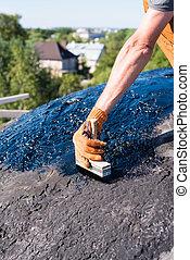 worker making waterproofing.