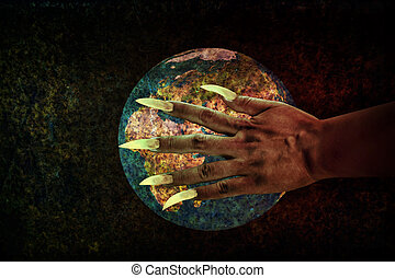 Human hand with long fingernail or devil hand on rusty earth...