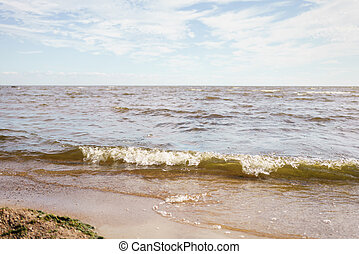 baltic sea, fin gulf coast in summer sunny day and waves